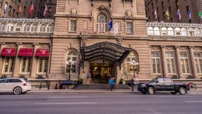 Time-lapse of the facade of the Fairmont Palliser Hotel stock video footage