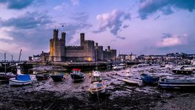 Time lapse of the falling tide at Caernafon castle at night, Gwynedd in Wales - United Kingdom.  stock footage