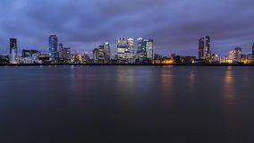 Twilight sky over Canary Wharf skyscrapers in London. Time lapse of famous financial centre skyscrapers in London, United Kingdom stock video