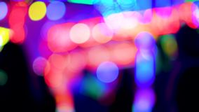Amusement park at night city defocused light time-lapse people. Time-lapse fast motion of defocused funny atmosphere at the amusement park in megapolis with stock video