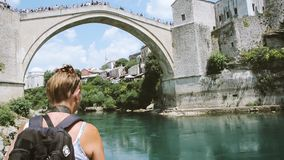 Time-lapse fast motion of female travel blogger vlogger Bosnia. Time-lapse fast motion of female travel blogger vlogger admiring and taking photos of UNESCO stock video