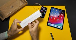 Time lapse fast motion man unboxing latest Apple pencil device stock video