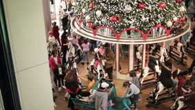 Time lapse. Fast motion. Many people ride on the carousel on horseback. Holidays in the mall. stock footage