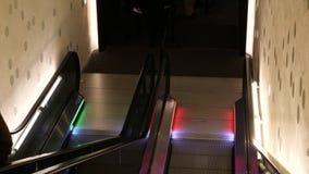 Time lapse fast motion people seniors on escalator