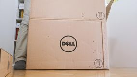 Time-lapse fast motion unboxing new computer Dell. LONDON, UNITED KINGDOM - CIRCA 2017: Time lapse fast motion Man geek unboxing unpacking Dell Workstation stock footage