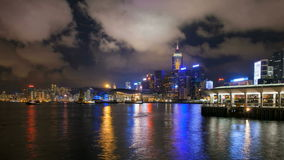 Time lapse of ferry and moving clouds at Ferry Pier in Victoria Harbour, Hong Kong at night. 1080p Royalty Free Stock Photos