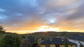Time lapse of fiery sunset over residential suburb homes in Happy Valley Oregon 4k. Ultra high definition 4k time lapse movie of fiery sunset and colorful clouds stock footage