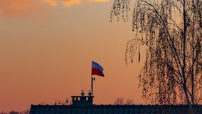 Time lapse - flag of Poland. Fluttering in the wind against beautiful colorful autumn sunset in countryside with wonderful light. Close up of Polish Flag stock video footage