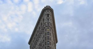 Time-lapse of Flatiron Building on 5th Ave in Manhattan, New York City. Flatiron Building and running sky timelapse stock video footage