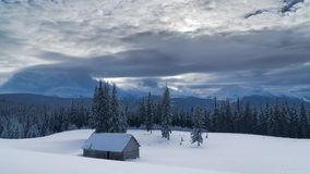 Time lapse of flowing clouds over the mountains and forest in winter stock video footage