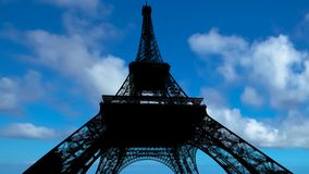 Blue sky Eiffel tower time-lapse. Time-lapse of fluffy clouds moving over blue sky on Eiffel tower in backlight in a sunny day in Paris city of France stock footage