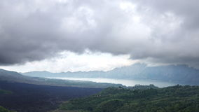 Time lapse,fog and clouds over a volcano and an lake Gunung-Batur or Batur, Bali Indonesia.  stock video footage