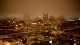 Time Lapse of Fog Passing over San Francisco Skyline at Night stock video