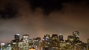 Time Lapse of Fog Passing over San Francisco Skyline at Night stock footage