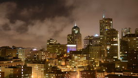 Time Lapse of Fog Passing over San Francisco Skyline at Night stock video footage