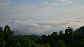 Morning fog rolls through the mountains and consumes the camera stock footage
