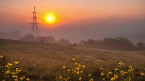 Sunrise on the background of a power line with thick fog. Time lapse. time lapse. Time lapse. Foggy morning and sunrise in time lapse mode on the background of stock video footage