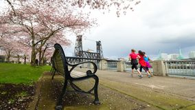 Time lapse of foot traffic and cyclists along waterfront park in Portland Oregon 4k uhd stock video