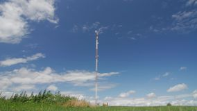 Time lapse footage with cellular tower and clouds moving fast. Summer day stock video