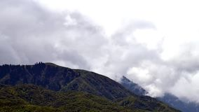 Time lapse footage of clouds in motion in the mountains, movement of clouds. stock video