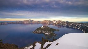 Time lapse footage of Crater Lake moving clouds and moon rise stock footage