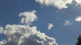 Time lapse footage of cumulus clouds stock footage