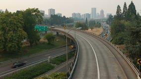 Time Lapse of Freeway Traffic with Portland Oregon Skyline on a Hazy Day 4096x2304 stock footage