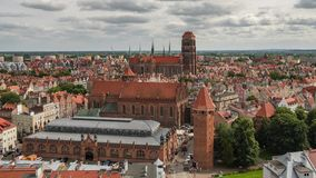 Time lapse of the Gdansk cityscape, Poland. Time lapse of the Gdansk cityscape. Aerial view of the old town with saint Marys church in Gdansk, Poland stock video footage