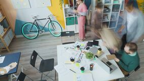 Time lapse of girls and guys business team working in creative office together