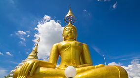 Time Lapse Gold Buddha Statue In Wat Chiang Yeun Temple Of Chiang Mai, Thailand And Beautiful Sky stock footage