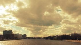 Time lapse golden clouds over the Malaya Neva River, Saint-Petersburg, Russia. stock footage