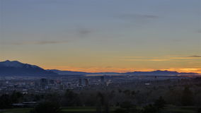 Time lapse golden sunset into cityscape stock video