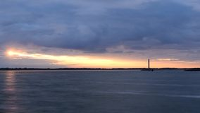 Time lapse of gorgeous sunrise with lighthouse stock video footage