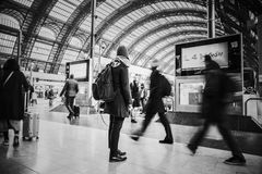 Time Lapse Grayscale Photograph of People Pass Through Inside Transportation Terminal Royalty Free Stock Photography