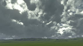 Time lapse on a green meadow with gloomy clouds stock video