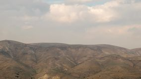 Time lapse - Moving clouds over the The Judaean Desert in Israel. Time lapse - grey clouds moving over the The Judaean Desert, Midbar Yehuda stock video