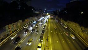 Time lapse of Heavy traffic on the East-West connection, Radial Leste Avenue, at nigh stock video footage