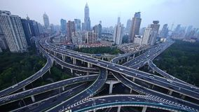 Time lapse,heavy traffic on highway interchange,Aerial View of Shanghai Skyline.