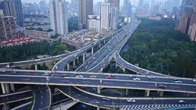 Time lapse,heavy traffic on highway interchange,Aerial View of Shanghai Skyline. Time lapse,Aerial View of freeway busy city rush hour heavy traffic jam highway stock video footage
