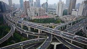 Time lapse,heavy traffic on highway interchange,Aerial View of Shanghai Skyline. Aerial View of freeway busy city rush hour heavy traffic jam highway,shanghai stock video