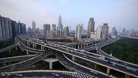 Time lapse,heavy traffic on highway interchange,Aerial View of Shanghai Skyline. Time lapse,Aerial View of freeway busy city rush hour heavy traffic jam highway stock footage