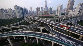 Time lapse,heavy traffic on highway interchange,Aerial View of Shanghai Skyline. Time lapse,Aerial View of freeway busy city rush hour heavy traffic jam highway stock video