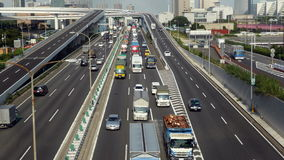 Time Lapse of Heavy Truck Traffic on Japanese Highway -   Tokyo Japan. Busy Highway of Trucks on way to Shipping Port stock footage