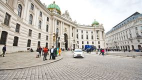 Vienna Hofburg Palace Timelapse. Time-lapse of the historic old town of Vienna, Austria. Michaelerplatz crowded by tourists, horse-drawn carriages and traffic on stock video footage