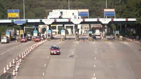 Time lapse of Hong Kong Tunnel, Toll Station at Lam Tin in Hong Kong, on DEC 16, 2016. HONG KONG - DEC 16 2015: Time lapse of Hong Kong Tunnel, Toll Station at stock footage
