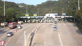 Time lapse of Hong Kong Tunnel, Toll Station at Lam Tin in Hong Kong. HONG KONG - DEC 16 2015: Time lapse of Hong Kong Tunnel, Toll Station at Lam Tin in Hong stock video