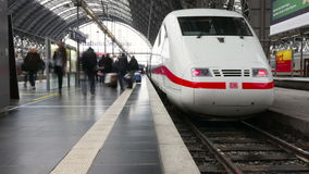 Time-lapse ICE train Frankfurt Hauptbahnhof. FRANKFURT, GERMANY - February 20, 2016: Time-lapse of arriving and departing ICE train and passengers on a railroad stock video