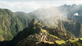 Time lapse of the iconic view of machu picchu on a misty morning