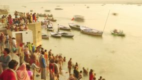 Time lapse Indian pilgrims rowing boat in sunrise. Ganges river at Varanasi India. Time lapse Indian pilgrims rowing boat in sunrise, Ganges river at Varanasi stock video footage