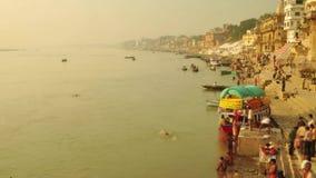 Time lapse Indian pilgrims rowing boat in sunrise. Ganges river at Varanasi India. Time lapse Indian pilgrims rowing boat in sunrise, Ganges river at Varanasi stock footage